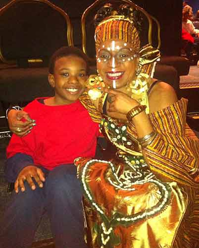 Characters from 'The Spirit of the Baobab Tree': Jelani and the storyteller Iyabo, played by griot Kposivi Clark