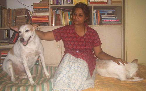 Artist Proiti Roy with two of her rescued dogs
