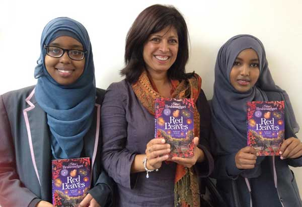 Sita Brahmachari with two of the Somali girls who petitioned her about the name of her character Aisha in Red Leaves (Macmillan, 2015)