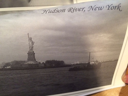 The postcard of the Hudson River that Hudson sends to his family in 'Car Wash Wish' by Sita Brahmachari (Barrington Stoke, 2016)