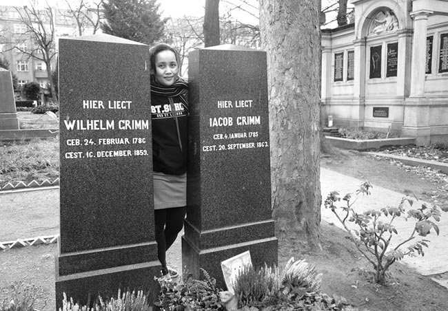 Author Catherine Torres visiting the graves of the Brothers Grimm at Alter St.-Matthäus-Kirchhof, Berlin