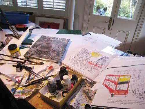 Artist and children's author Leigh Hobbs' studio during preparation for Mr Chicken Lands on London - plus dog!